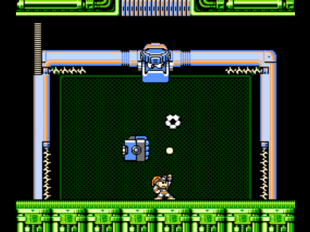 [BASS...TACKLING ONE OF THE MORE DIFFICULT MINI-BOSSES IN THE GAME. AND YES, THAT IS A SOCCER BALL IN A MEGA MAN GAME.]